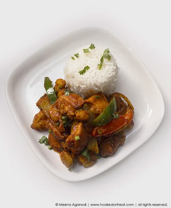 Recipe for Kadhai Chicken (Stir-fried Chicken with Peppers) taken from www.hookedonheat.com. Visit site for detailed recipe.