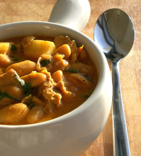 Recipe for Chicken & White Bean Stew taken from www.hookedonheat.com. Visit site for detailed recipe.