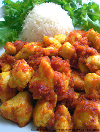 Recipe for Ayam Masak Merah (Malay-style Chicken in Spicy Tomato Sauce) taken from www.hookedonheat.com. Visit site for detailed recipe.