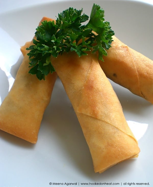 Recipe for Chicken Spring Rolls taken from www.hookedonheat.com. Visit site for detailed recipe.