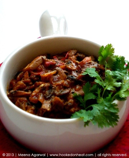 Recipe for Achari Mushroom taken from www.hookedonheat.com. Visit site for detailed recipe.