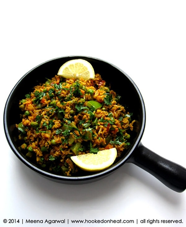 Recipe for Tawa Pulao taken from www.hookedonheat.com. Visit site for detailed recipe.