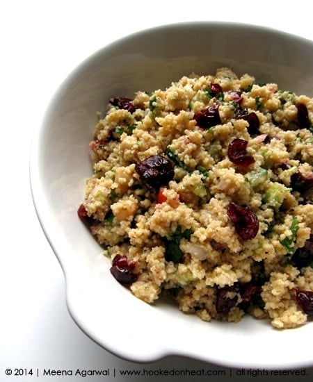 Recipe for Cranberry Cous Cous Salad taken from www.hookedonheat.com. Visit site for detailed recipe.