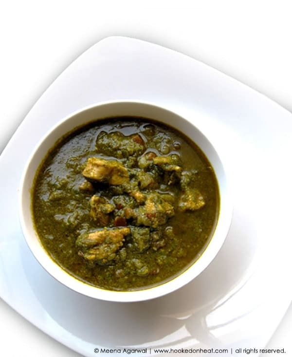 Recipe for Saag Chicken (Chicken cooked in Pureed Spinach) taken from www.hookedonheat.com. Visit site for detailed recipe.