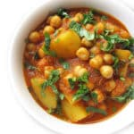 Recipe for Alu Chana taken from www.hookedonheat.com. Visit site for detailed recipe.