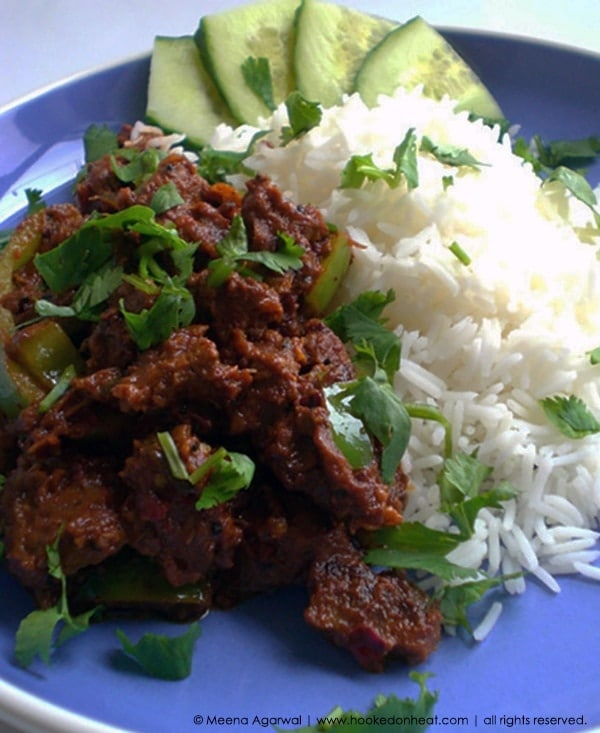 Recipe for Spiced Lamb with Peppers taken from www.hookedonheat.com. Visit site for detailed recipe.