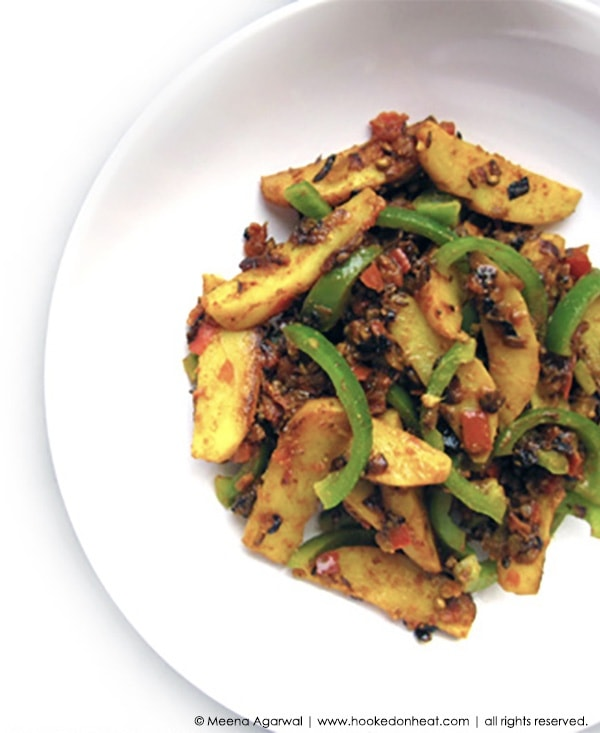 Recipe for Alu Shimla Mirch taken from www.hookedonheat.com. Visit site for detailed recipe.