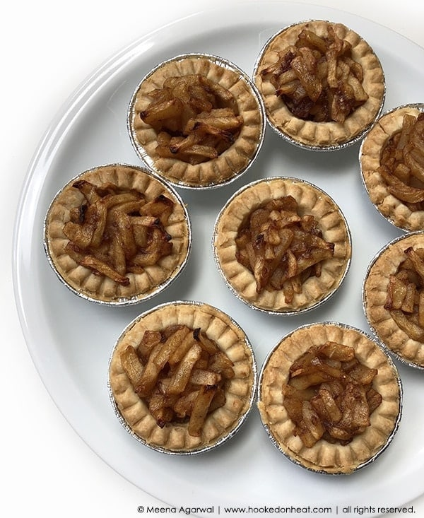 Recipe for Apple Pie Tarts taken from www.hookedonheat.com. Visit site for detailed recipe.