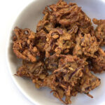 Recipe for Onion Pakoda (Onion Fritters) taken from www.hookedonheat.com. Visit site for detailed recipe.
