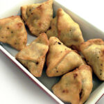 Recipe for Potato Samosas taken from www.hookedonheat.com. Visit site for detailed recipe.