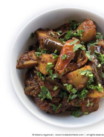 Recipe for Aloo Baingan (Potato & Eggplant Stir-fry) taken from www.hookedonheat.com. Visit site for detailed recipe.