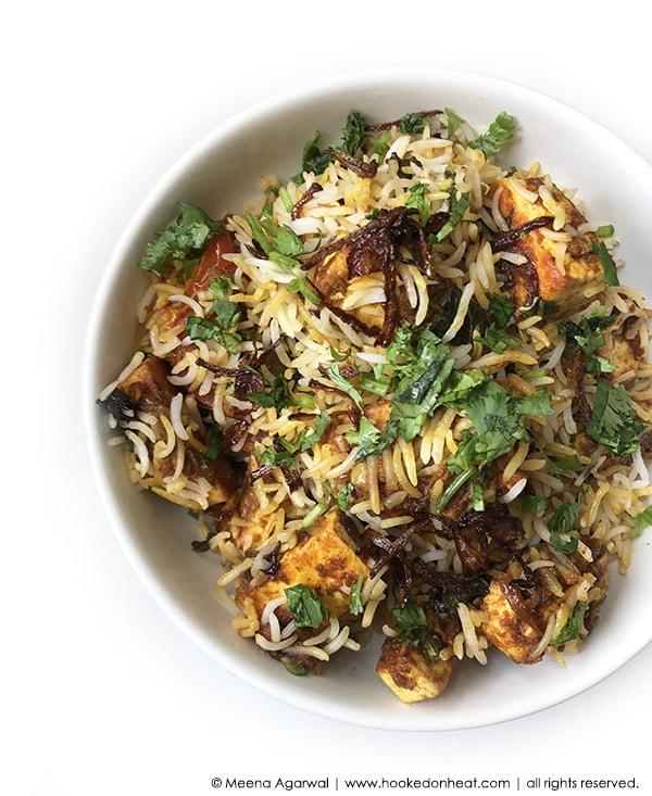 Recipe for Paneer Biryani taken from www.hookedonheat.com. Visit site for detailed recipe.