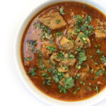 Recipe for Achari Gosht (Hot & Sour Lamb Curry) taken from www.hookedonheat.com. Visit site for detailed recipe.