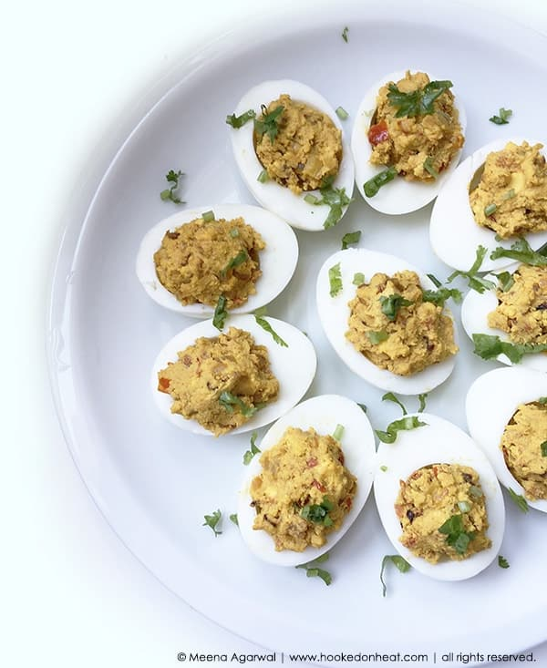 Recipe for Spicy Masala Devilled Eggs taken from www.hookedonheat.com. Visit site for detailed recipe.
