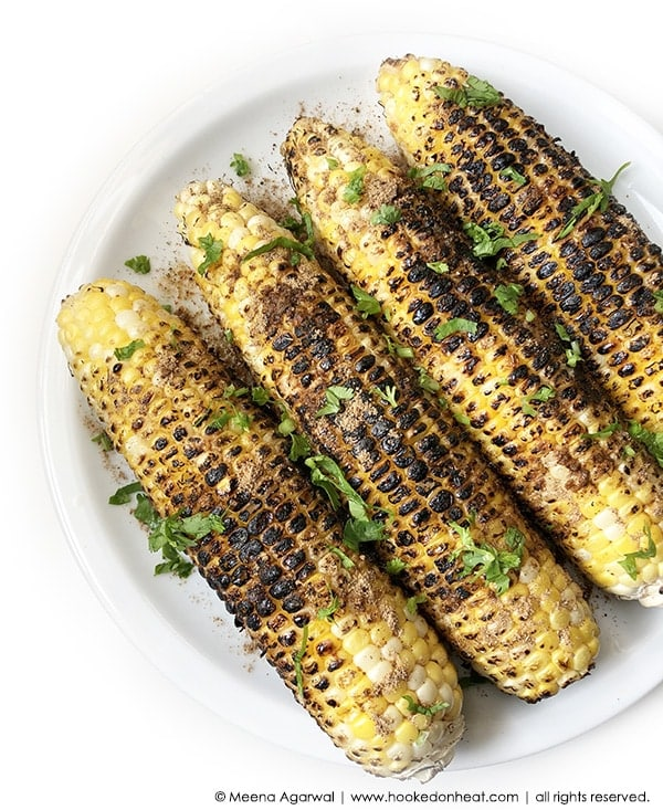 Recipe for Indian-style Spiced Grilled Corn (Bhutta) taken from www.hookedonheat.com. Visit site for detailed recipe.